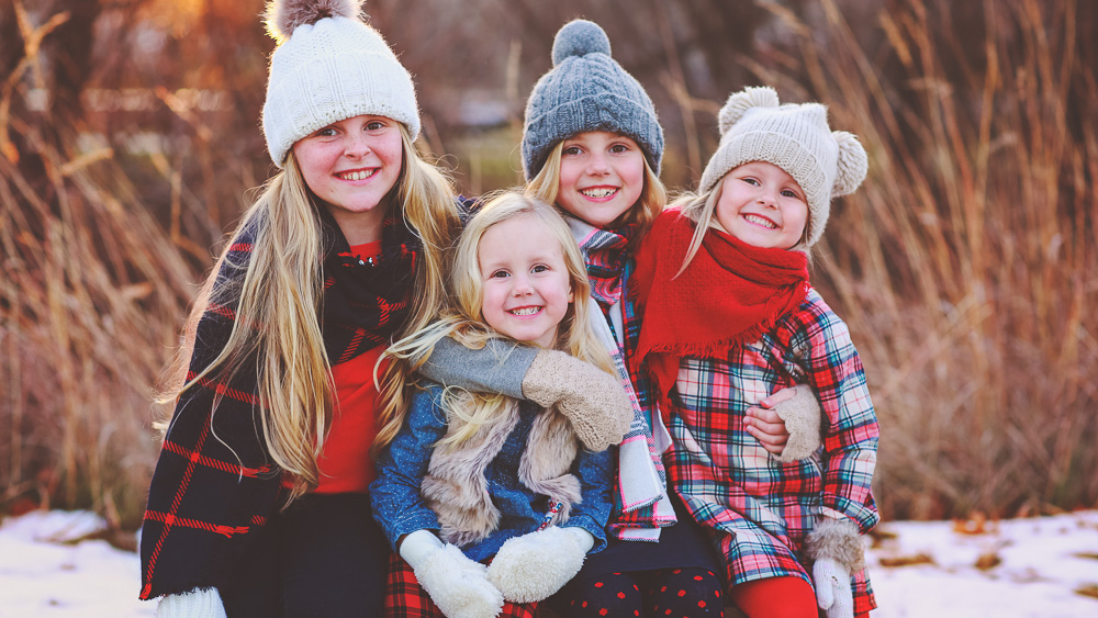 photograph of the austin girls during a winter photo session in ankeny iowa dressed in winter clothes